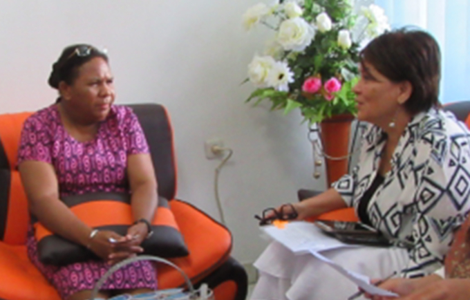 Head of Jayapura District Planning Agency Hanna Hikoyabi (left) discusses elimination of violence against women and girls with UNFPA Representative Dr. Annette Sachs Robertson.